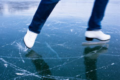 Young woman ice skating outdoors Stock Photography
