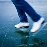 Young woman ice skating outdoors Stock Photo