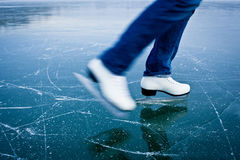 Young woman ice skating outdoors Stock Images