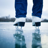 Young woman ice skating outdoors Stock Image