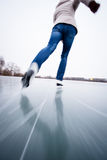 Young woman ice skating outdoors on a pond Royalty Free Stock Photography