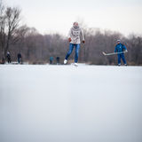 Young woman ice skating outdoors on a pond Stock Photography