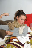 Young woman is ill in bed Royalty Free Stock Photo