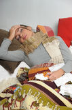 Young woman is ill in bed Royalty Free Stock Photography