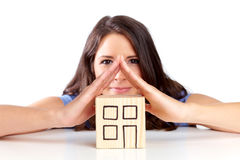Young woman illustrates a roof with hands Stock Photography