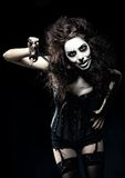 Young woman in the image of evil gothic freak clown with scissors Royalty Free Stock Image