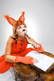 Young woman in image of squirrel writing with quill pen Stock Photo