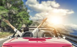 Free Young Woman In A Car On The Road To The Sea Against A Backdrop Of Beautiful Mountains On A Sunny Day. Stock Photo - 115186110