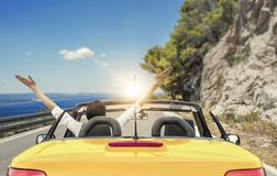 Free Young Woman In A Car On The Road To The Sea Against A Backdrop Of Beautiful Mountains On A Sunny Day. Stock Images - 115247234
