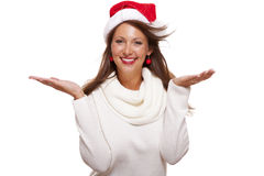 Young Woman In A Santa Hat Holding Out Her Hands Royalty Free Stock Image