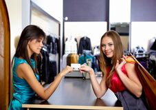 Free Young Woman In A Shop Buying Clothes Stock Photos - 18590423