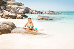 Free Young Woman In A Swimsuit On A Stoney Beach Stock Photography - 66253722