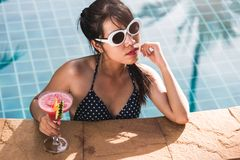 Free Young Woman In Bikini Swimming Pool Drinking Juice Cocktail Royalty Free Stock Photo - 168342915