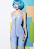 Young Woman In Blue Overalls And Creative Wig Stock Images