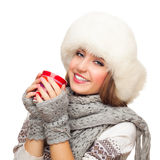 Young Woman In Cap And Mittens Holds Cup Royalty Free Stock Photos