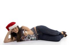 Young Woman In Christmas Hat Lying On Floor Royalty Free Stock Image