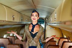 Free Young Woman In Flight Attendant Clothes. Happy Smiling Woman Stewardess In Uniform Waiting For Her Flight. Stewardess Stock Photos - 160164213