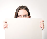 Young Woman In Glasses Holding A White Card Stock Photography