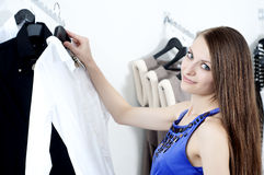 Young Woman In Mall Buying Clothes Royalty Free Stock Images