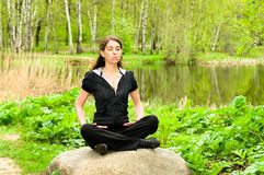 Young Woman In Meditation Pose Stock Photo