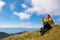 Young Woman In Mountains - Taking Picture Royalty Free Stock Images