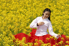 Young Woman In The Flower Garden Stock Photo