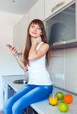 Young Woman In The Kitchen Listening To Music Stock Photos