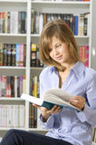 Young Woman In The Library Stock Image