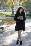 Young Woman In The Park With Tablet Pc Stock Image