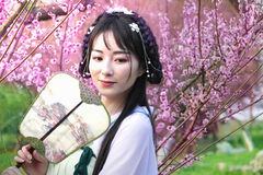 Young Woman In The Plum Garden Royalty Free Stock Photo