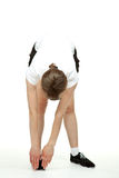 Young woman inclining in sport clothes Stock Image