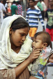 Young woman from India. Young and slum woman with a baby on the traditional festival Diwali, New Delhi, India.Diwali is a five day festival that represents the Royalty Free Stock Images