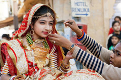 Young woman in indian dress sari wears jewelry Stock Photos