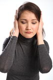 Young woman indicates bad news not listening Stock Image