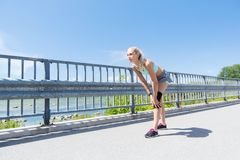 Young woman with injured knee or leg outdoors Royalty Free Stock Images