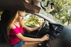 Confused young blond girl insert car key royalty free stock photo