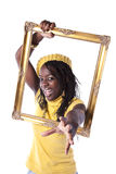 Young woman inside a picture frame Stock Photos
