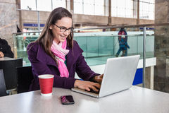 Woman inside Train Station Royalty Free Stock Photography