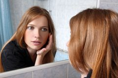 Young woman inspected skin Royalty Free Stock Photography