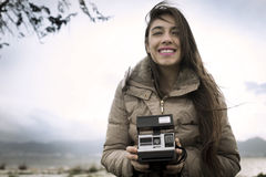 Young woman with an instant camera Stock Image