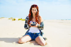 Young woman with instant photo camera Royalty Free Stock Photography