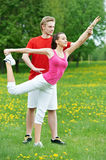 Young woman and instructor doing exercises Royalty Free Stock Photography