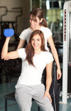 Young woman and instructor in the gym Stock Image