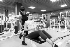 Young woman with an instructor in the gym Stock Photos