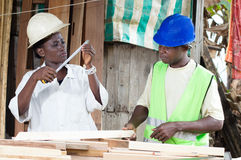 Young woman intern in carpentry. Stock Photography