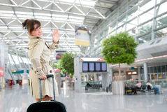 Young woman at the international airport. Young woman leaving at the international airport Stock Photo
