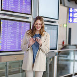 Young woman at international airport, checking electronic board Stock Image