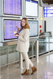 Young woman at international airport, checking electronic board Stock Photography