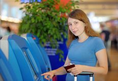 Young woman at the international airport Royalty Free Stock Photo