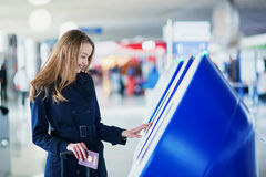 Young woman in international airport Royalty Free Stock Image